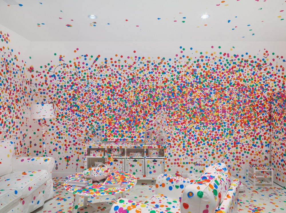 Yayoi Kusama, The obliteration room (2002-present). Furniture, white paint, dot stickers. Dimensions variable. Pictured: Collaboration between Yayoi Kusama and Queensland Art Gallery. Commissioned Queensland Art Gallery, Australia. Courtesy of KUSAMA Enterprise, Ota Fine Arts, Tokyo/Singapore and David Zwirner, New York